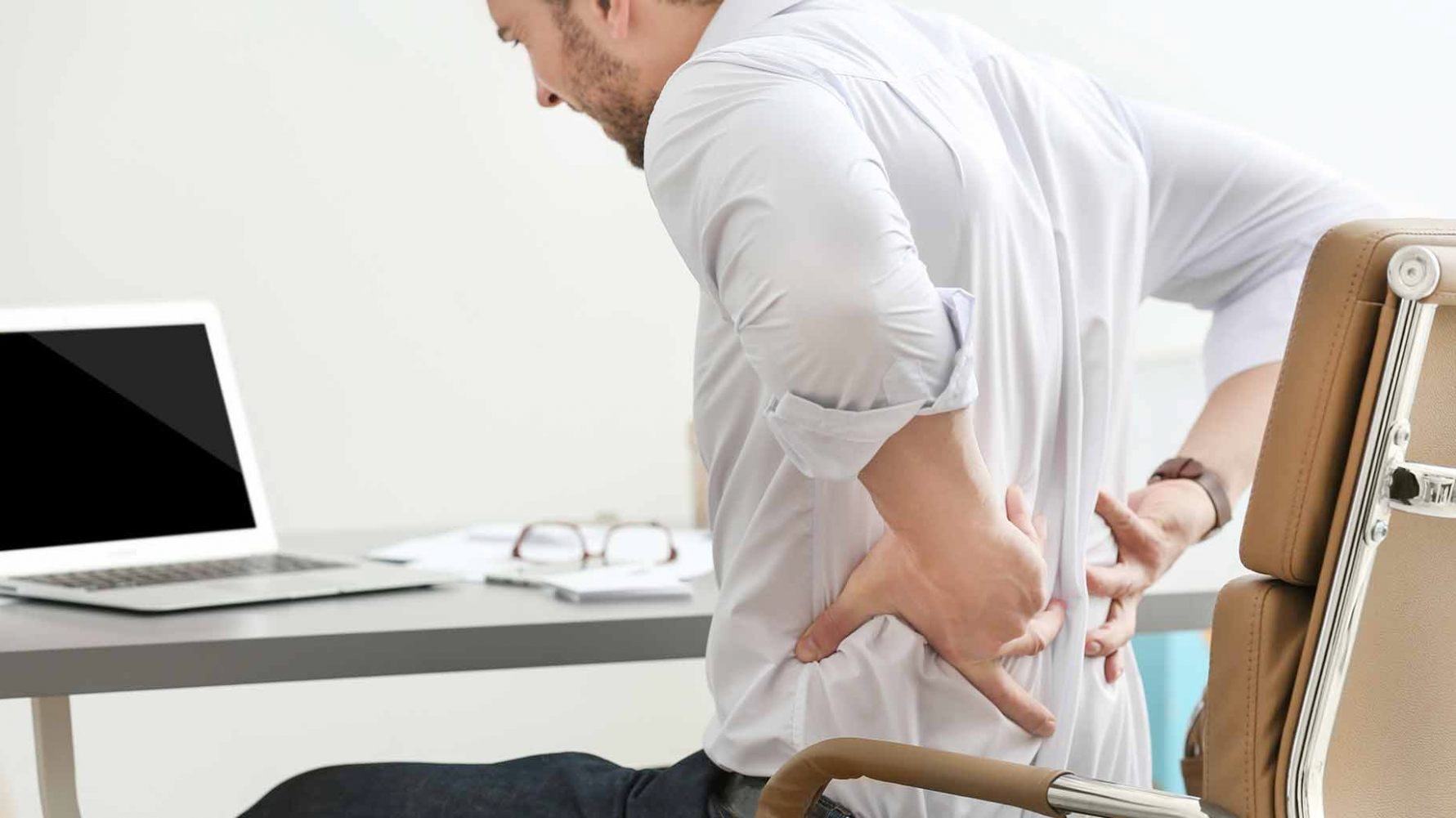 lower-back-pain-when-rising-from-chair-6-sitting-time-office-computer-use-standing-breaks-back-pain-stiffness-natural-remedies-1781-x-1001