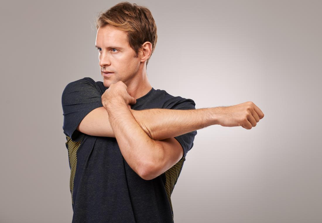 man-doing-cross-body-shoulder-stretch-for-arm-warmup